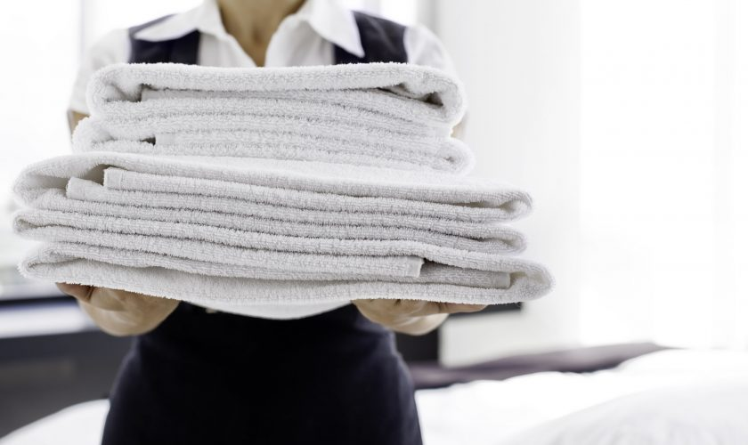 maid-with-clean-towels-175521151-5771715a3df78cb62c83e186